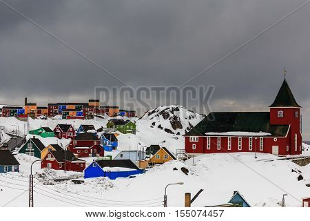 Old church and colorful houses landscape, Sisimiut, Greenland