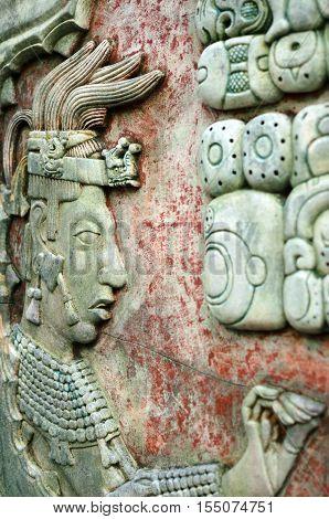 PALENQUE MEXICO DECEMBER 15 2015: Mayan man image and Mayan writing symbols on an ancient wall