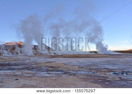 Geysers field expelling vapor columns at sunrise.