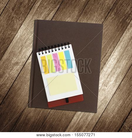 notebook and notepaper on wooden background. objects equipment