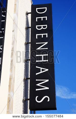 Carmarthen, Wales, UK, October 22, 2016 :  Debenhams logo advertising sign outside one of  its department stores in the city centre