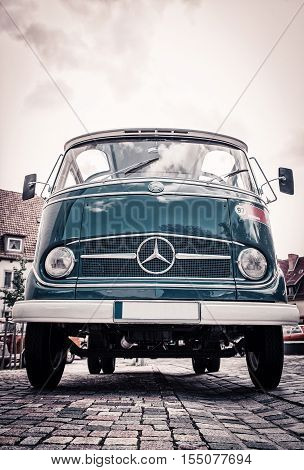 Old minibus Mercedes on the street front view. HILDESHEIM GERMANY - JULY 30, 2016,  parade of vintage cars.