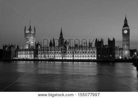 Night view of Big Ben Clock Tower and the Houses of Parliament at city of Westminster London UK (black and white)