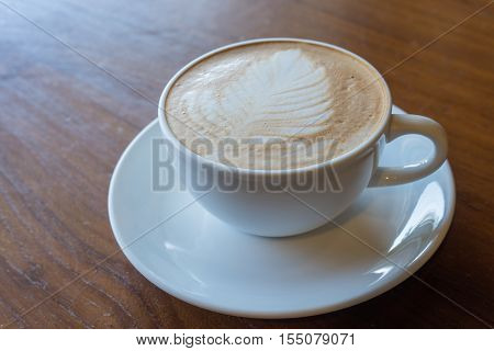 Cup Of Hot Coffee On Old Wooden Table Background.