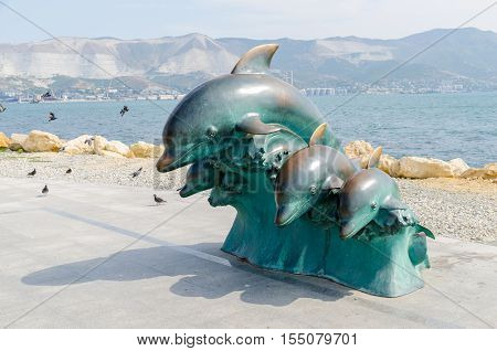 Novorossiysk Krasnodar Krai Russia - August 28 2016. Bronze dolphins. Urban sculpture on the Shore Promenade of Novorossiysk.