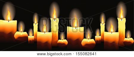 Burning candles on black. Seamless background. Beautiful glowing candles with melted wax.