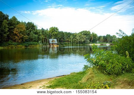 The house in the woods near the river. House and catamaran. Helicopter pad.