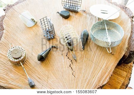 Carpfishing, background wooden background weights. Fishing Accessories.