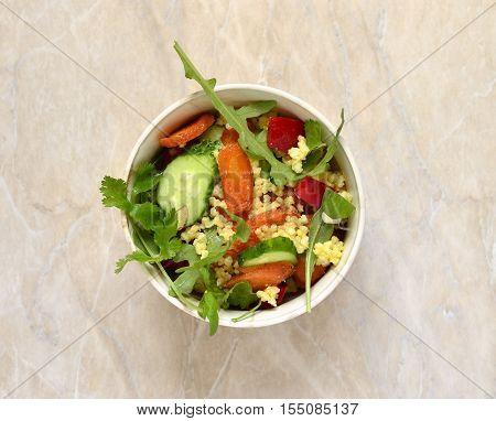 Moroccan salad: carrots millet herbs pepper, top view