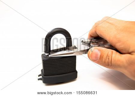 The man with the help of pliers to break the lock.