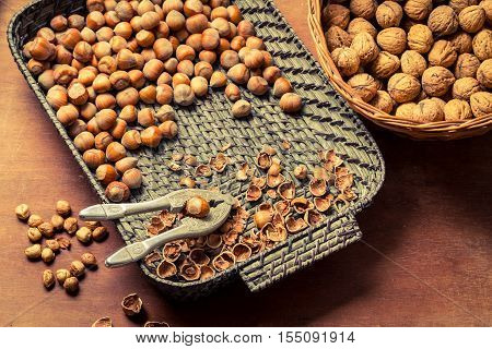 Hazelnuts With Nutcracker And Nutshel In Old Basket