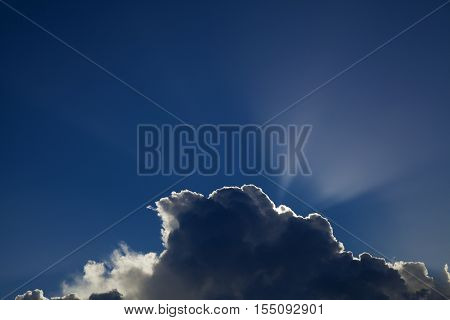 Sun Behind Cumulus Clouds