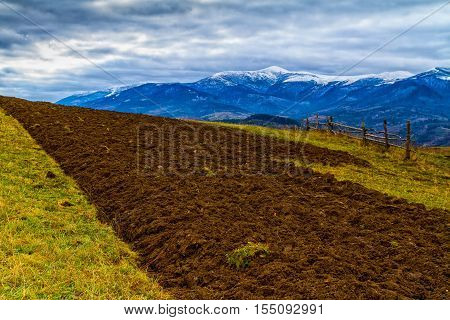 Volovets Ukraine - November 4 2016: Beautiful snow-capped peaks of the Carpathians autumn foggy morning after a snowfall.