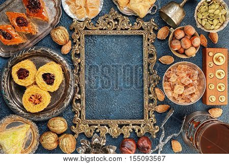 Large set of Eastern Arab Turkish sweets with frame top view copy space
