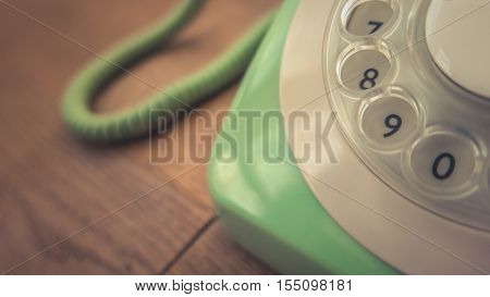 Detail Of A Pastel Green Vintage Rotary Telephone On A Rustic Wooden Table With Copy Space