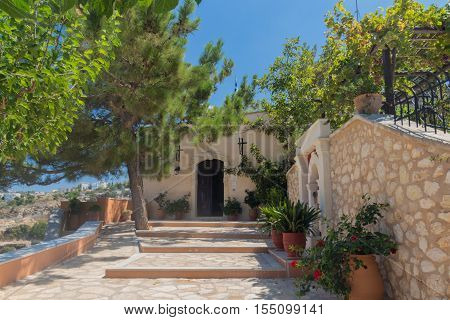 Agia Irini Monastery Greece. Set on the foot of the mount Vrysina on the northeast of the city of Rethymnon the Holy Monastery of Agia Irini is one of the oldest in Crete and it is dated from the 2nd Byzantine period.