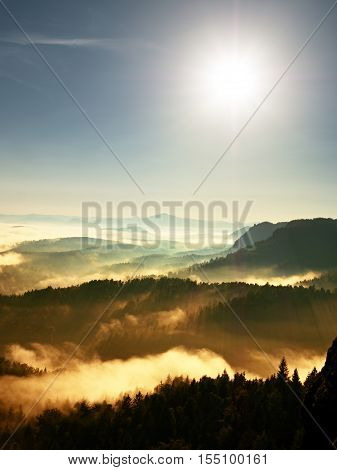 Colorful Fall Daybreak. Misty Awakening In A Beautiful Hills. Peaks Of Hills