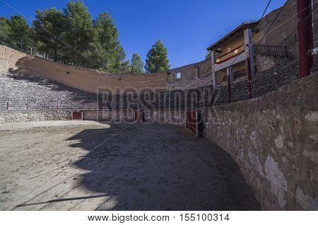 Alcala del Jucar Spain - October 29 2016: Ancient bullring this square is constructed in the shape of ship and byline of the year 1902 next to the banks of the river Jucar take in Alcala of the Jucar Albacete province Spain