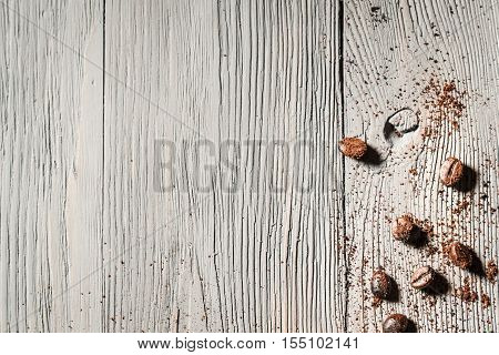 Coffe seed on old wooden table as background