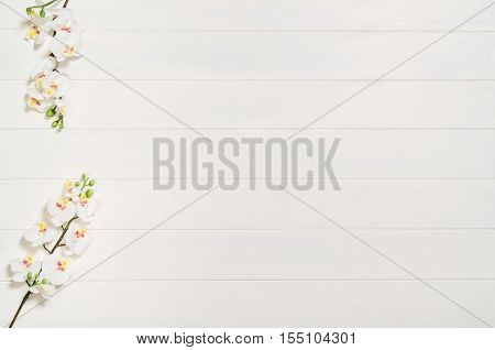 Feminine, elegant woman's white, wooden table, desk or workspace seen from above. Top view background with copy space. Creative workspace for freelance girl working from home poster