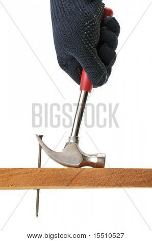 Carpenter pulls a nail. Isolated on white.