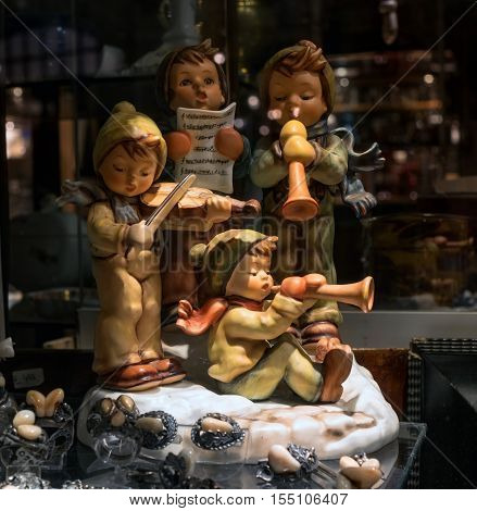 Munich, Germany - October 12, 2016: Showcase antique shop. In the showcase presented porcelain figurines. Four boys playing musical instruments.