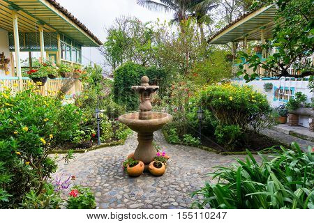 Lush green garden and fountain in a colonial house in Salento Colombia