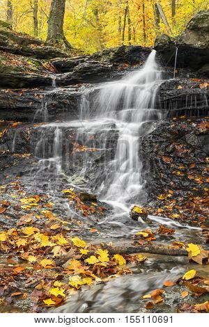 Colorful autumn leaves decorate a small Owen County Indiana waterfall.