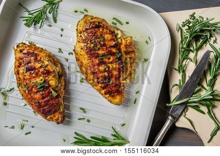Fried Chicken Breast With Rosemary On A Pan