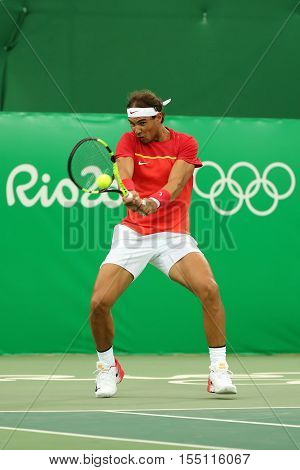 RIO DE JANEIRO, BRAZIL - AUGUST 12, 2016: Olympic champion Rafael Nadal of Spain in action during men's singles first round match of the Rio 2016 Olympic Games at the Olympic Tennis Centre