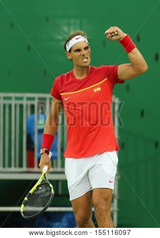 RIO DE JANEIRO, BRAZIL - AUGUST 12, 2016: Olympic champion Rafael Nadal of Spain celebrates victory after men's singles first round match of the Rio 2016 Olympic Games at the Olympic Tennis Centre