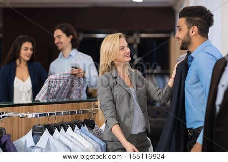 Handsome Business Man And Woman Fashion Shop, Customers Choosing Clothes In Retail Store Young People Shopping Formal Wear