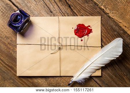 Feather On Envelope With Red Sealant And Inkwell