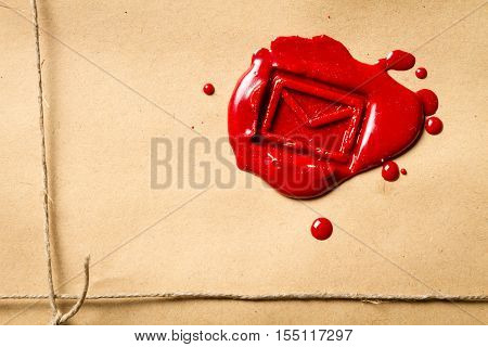 Close-up On The Envelope Symbol Imprinted In Red Sealing Wax