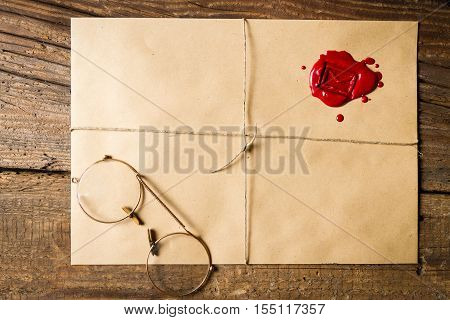 Envelope With Imprinted Sealing Wax And Old Glasses