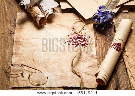 Old Scrolls With Red Sealant, Glasses And Blue Ink In The Inkwell