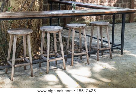 Outdoor wooden tables and chairs stock photo