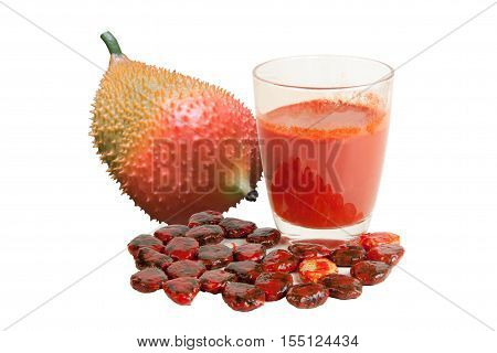 Baby Jack fruit isolated (Or Cochinchin Gourd Spiny Bitter Gourd Sweet Gourd Momordica cochinchinensis Momordica cochinchinensis (Lour) Spreng.) and juice or aril seeds and white background