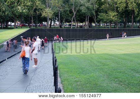WASHINGTON D.C.,USA - AUGUST 14,2016 : Visitors at the Vietnam Veterans Memorial in Washington D.C.