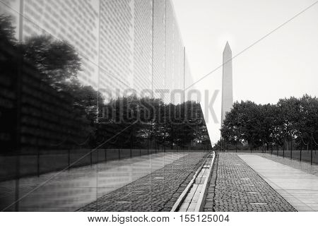 WASHINGTON D.C.,USA - AUGUST 14,2016 : The Vietnam Veterans Memorial in Washington D.C. with the Washington Monument on the background