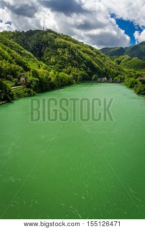 Turquoise river in the background of Alps