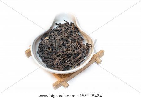 Traditional Chinese tea. Puer. Lao Shu. Tea on a white background.