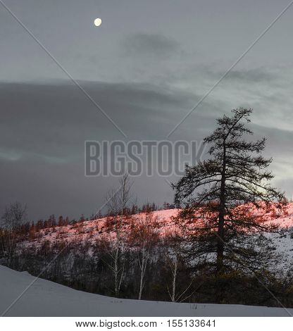 Moon photo of snow-capped mountains in the evening