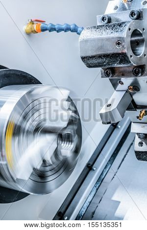 Rotary lathe chuck CNC metal cutting machine tool and tool holder.