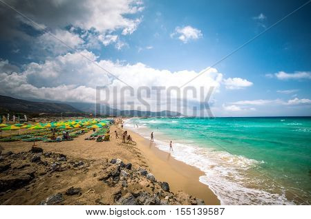 CRETE, GREECE - JUNE 26: People relaxing at Falassarna beach in Crete, Greece on 26 June 2016. Falasarna is one of the best Greek beaches.
