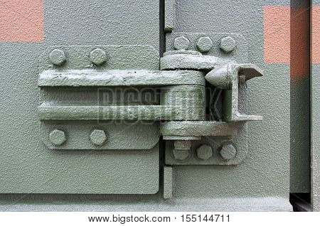 Photo shows very sturdy and robust metal hinges
