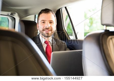 Hispanic Man Working While Riding A Car