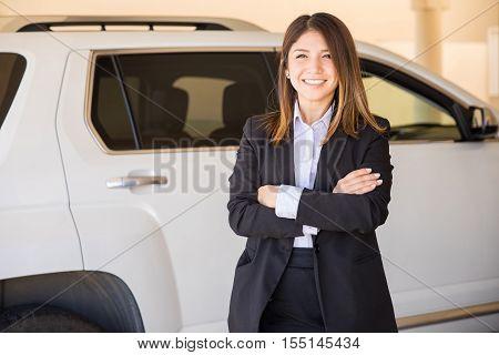 Cute Saleswoman In A Car Dealership