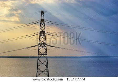 High-voltage line on river. transporting electrical energy. high voltage tower