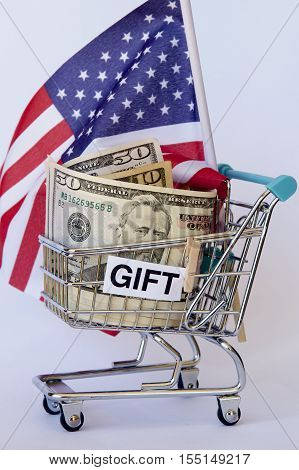 American dollar notes and flag in a trolley as a gift.
